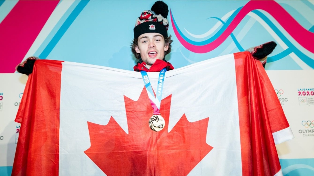 Andrew Longino poses with the Canadian flag