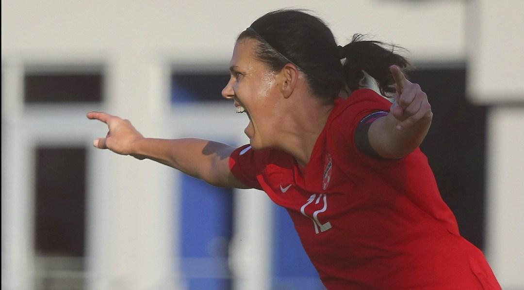 Canada's Christine Sinclair celebrates after scoring.