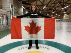 Lauren holds the Canadian flag.
