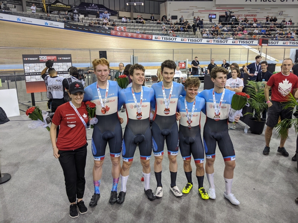 The men's team pursuit group poses for a group medal after receiving their bronze medals.