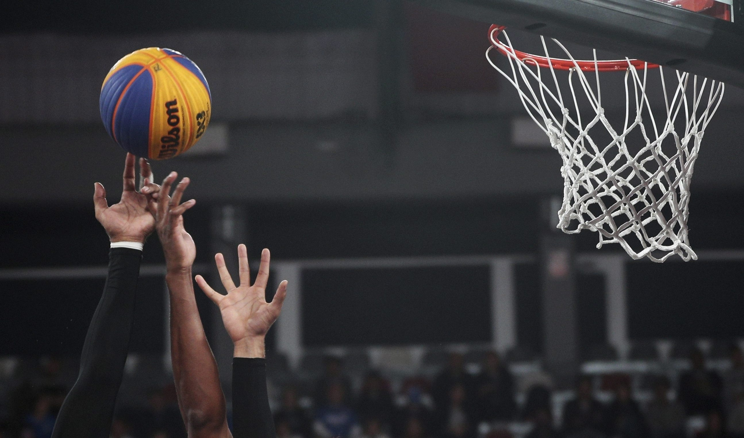 Teammates double up to block a shot during the men's basketball 3x3 semi-final match at the Pan American Games in Lima, Peru,