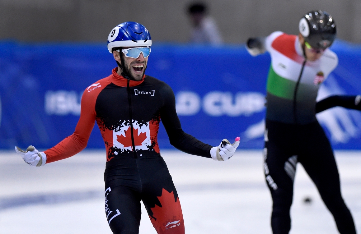 Canada's Steven Dubois celebrates as he crosses the finish line of the men's 500 meters race at the World Cup