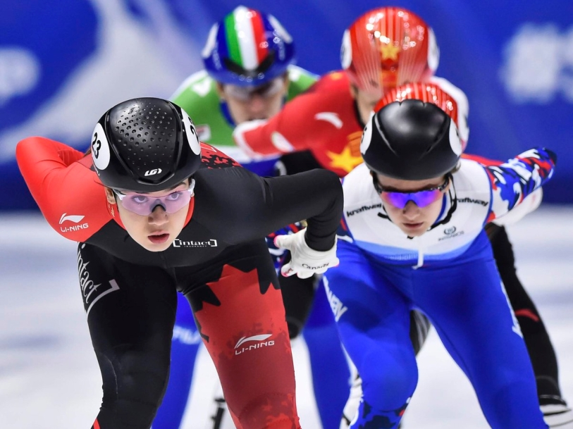 Team Canada's Courtney Sarault competes in a speed skating competition