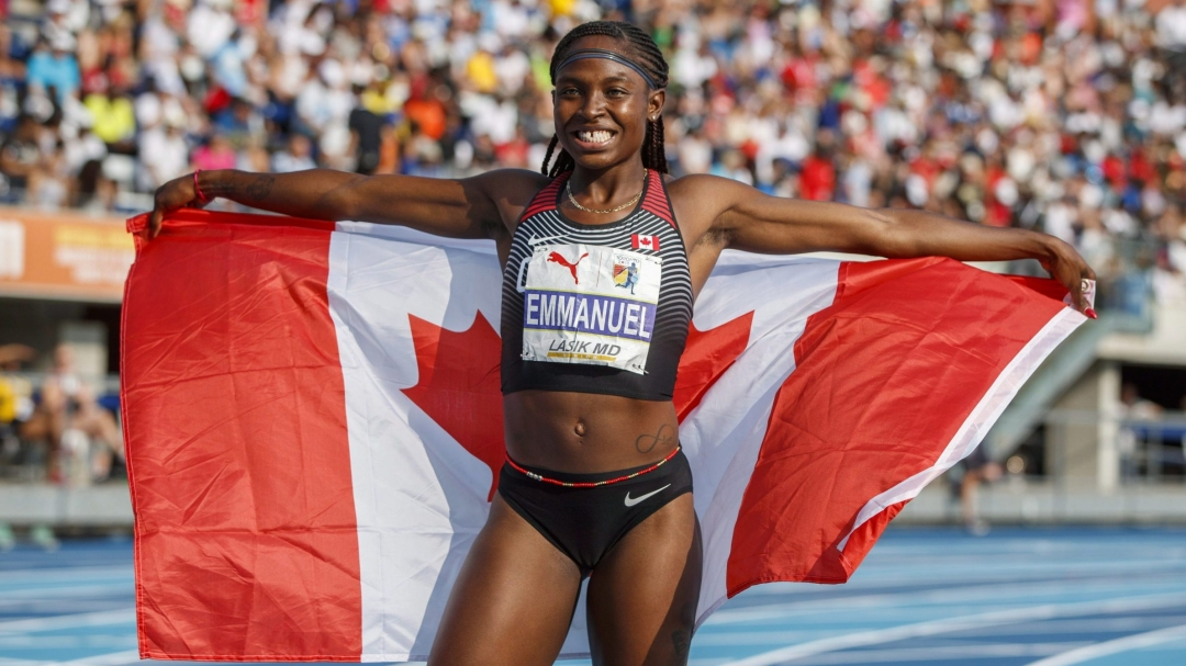 Crystal Emmanuel poses with the Canadian flag