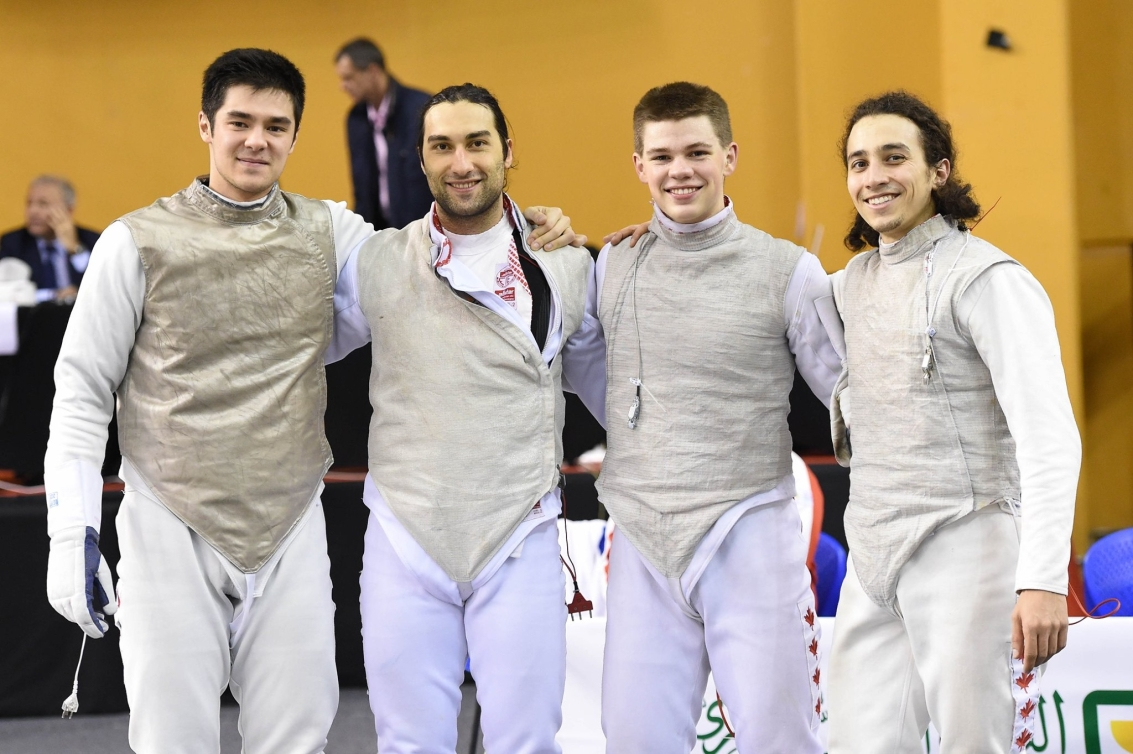 The men's team foil team poses for a group photo
