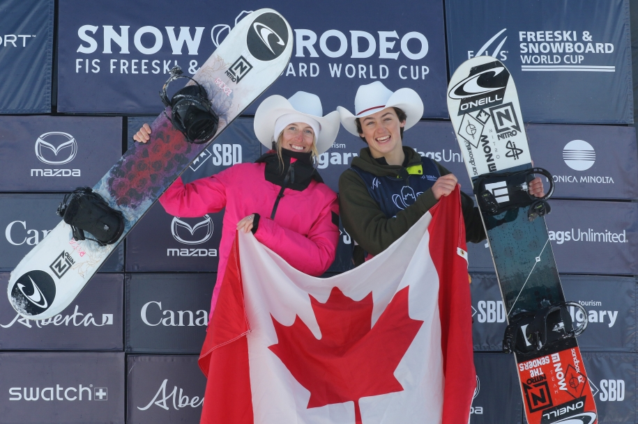 Gold medalist Laurie Blouin of Canada celebrates with Men's bronze medalist Liam Brearley of Canada in the finals of the FIS Snowboard World Cup