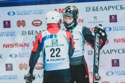 Lewis Irving (right) shakes hands with USA's Justin Schoenfeld on the podium.
