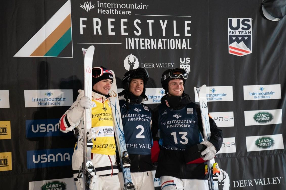 The men's moguls podium featuring Mikaël Kingsbury (left), Ikuma Horishma (centre) and Felix Elofsson (right).