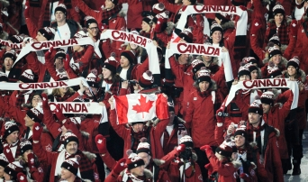 Canada's Clara Hughes carries the flag during the opening ceremony for the Vancouver 2010 Olympics in Vancouver, British Columbia, Friday, Feb. 12, 2010.