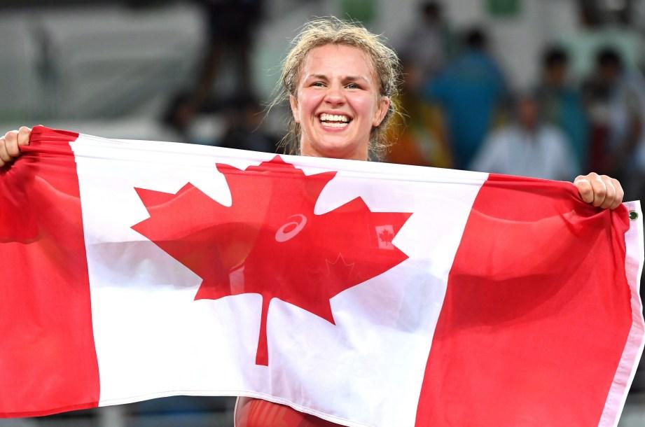 Canada's Erica Wiebe, of Ottawa, celebrates after winning the gold medal in the women's 75-kilogram freestyle wrestling against Kazakhstan's Guzel Manyurova at the 2016 Summer Olympics in Rio de Janeiro, Brazil, Thursday, August 18, 2016.