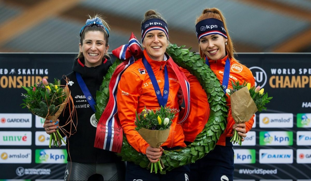 From left, Canada's silver medalist Ivanie Blondin, gold medalist Ireen Wust of the Netherlands and bronze medalist Antoinette de Jon of the Netherlands pose on the podium during the women's medal ceremony at the World Cup skating All-round 2020 in the Viking ship at Hamar, Norway, Sunday, March 1, 2020. (Geir Olsen/NTB Scanpix via AP)