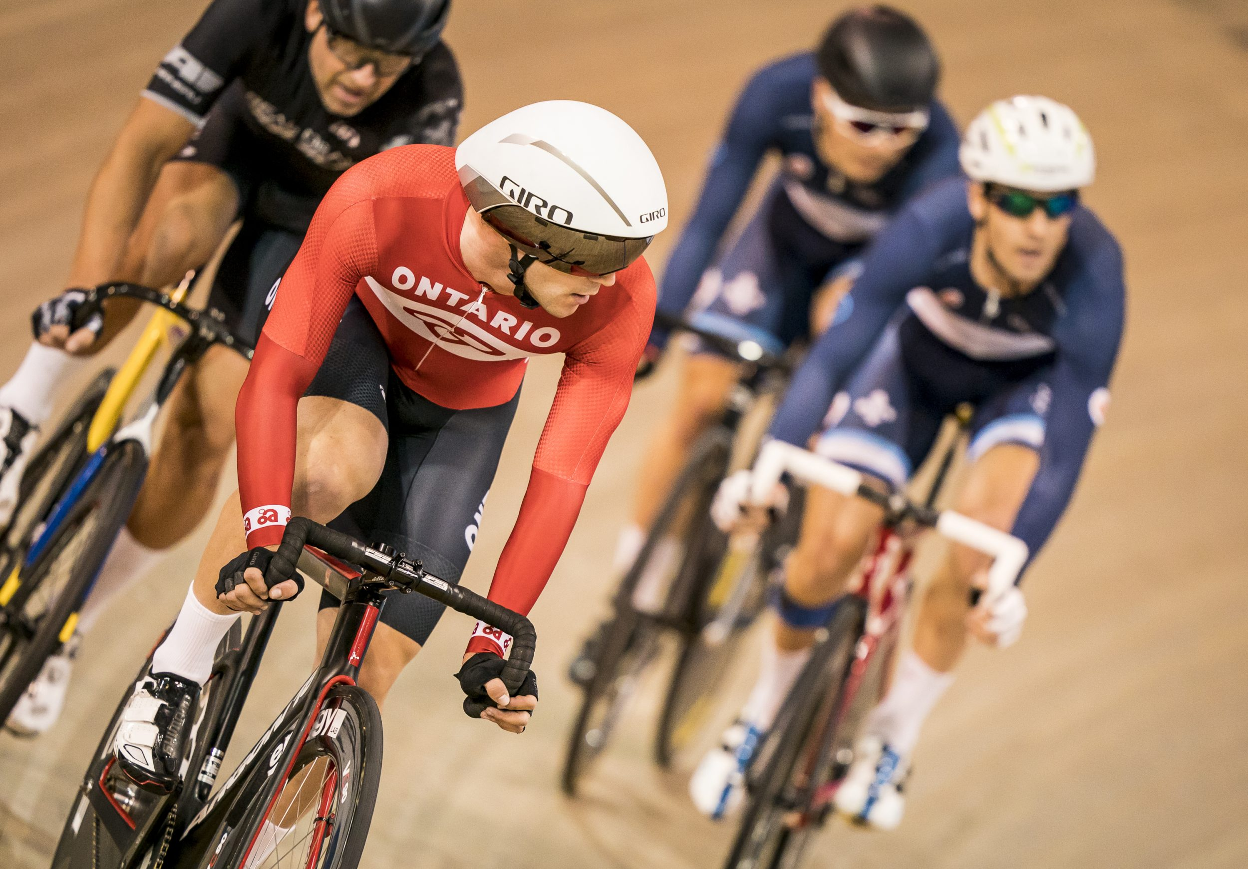 Vincent de Haitre racing on his bike