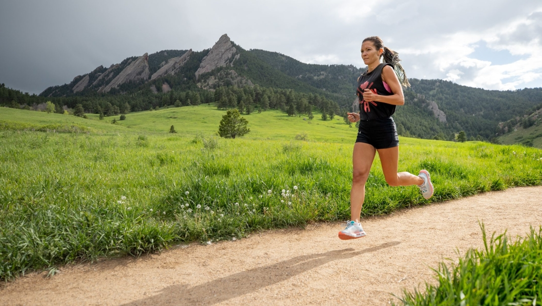 Lanni Marchant running on front of mountains