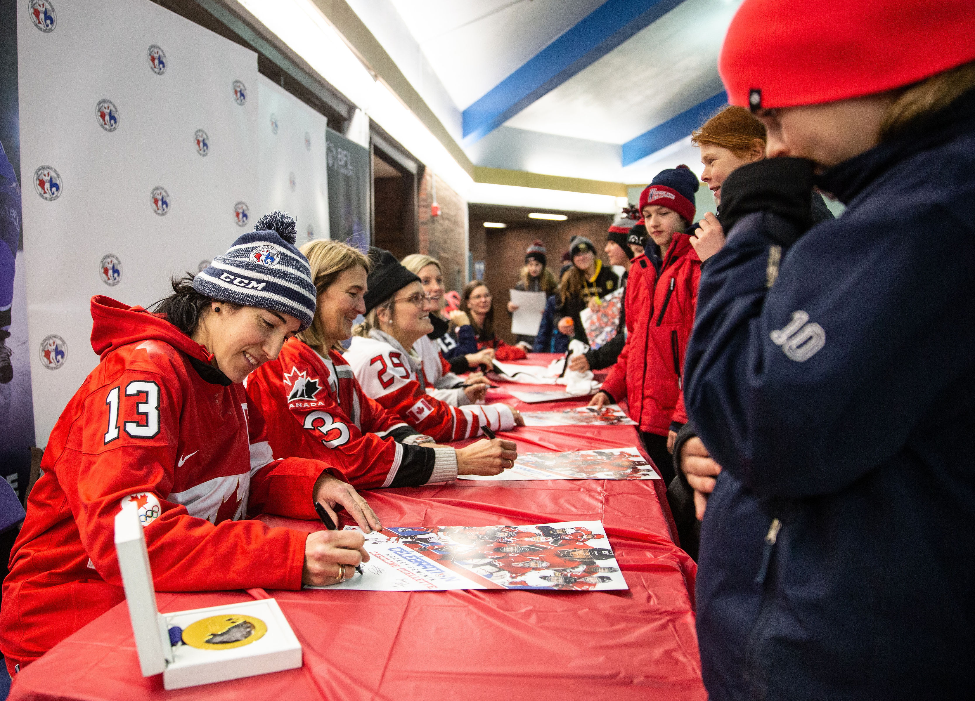 Players signing autographs
