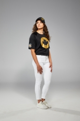 Kylie Masse is facing the camera in Tokyo 2020 closing ceremony t-shirt and jeans