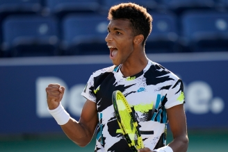 Felix Auger-Aliassime, of Canada, celebrates after winning a match against Corentin Moutet, of France, during the third round of the US Open tennis championships, Saturday, Sept. 5, 2020, in New York. (AP Photo/Frank Franklin II)