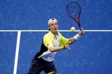 Denis Shapovalov, of Canada, eyes a return to Pablo Carreno Busta, of Spain, during the quarterfinal round of the US Open tennis championships, Tuesday, Sept. 8, 2020, in New York. (AP Photo/Frank Franklin II)