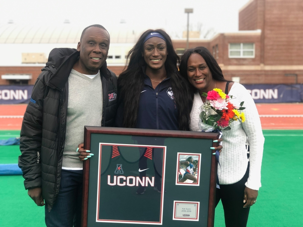 Bruny Surin poses with his daughter Katherine and his wife