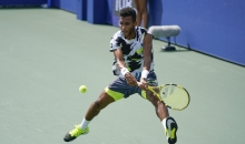Felix Auger-Aliassime, of Canada, returns a shot to Thiago Monteiro, of Brazil, during the first round of the US Open tennis championships, Tuesday, Sept. 1, 2020, in New York. (AP Photo/Seth Wenig)