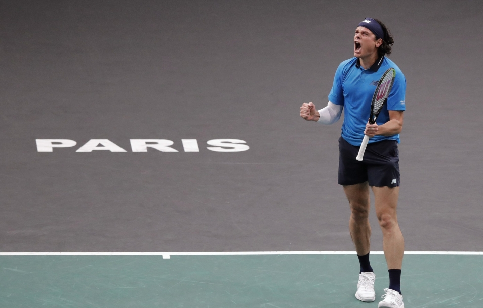 Milos Raonic celebrates victory in the quartefinals at the Paris Masters