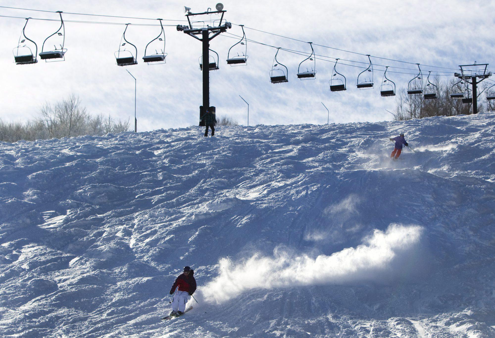 Skier descends down Blue Mountain hill