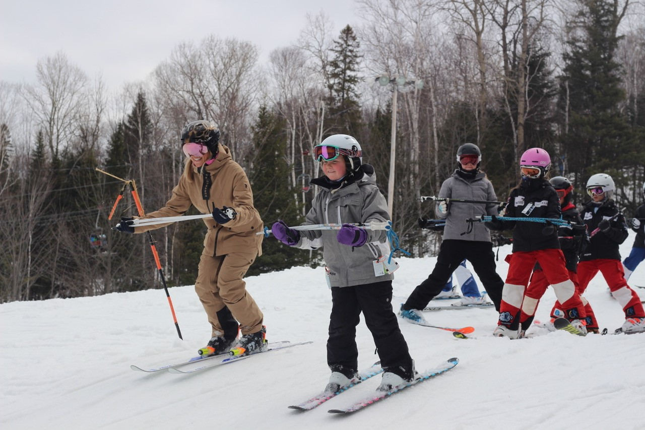 Young skiers going down a hill