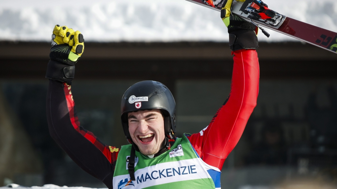 Skier celebrates with arms in air