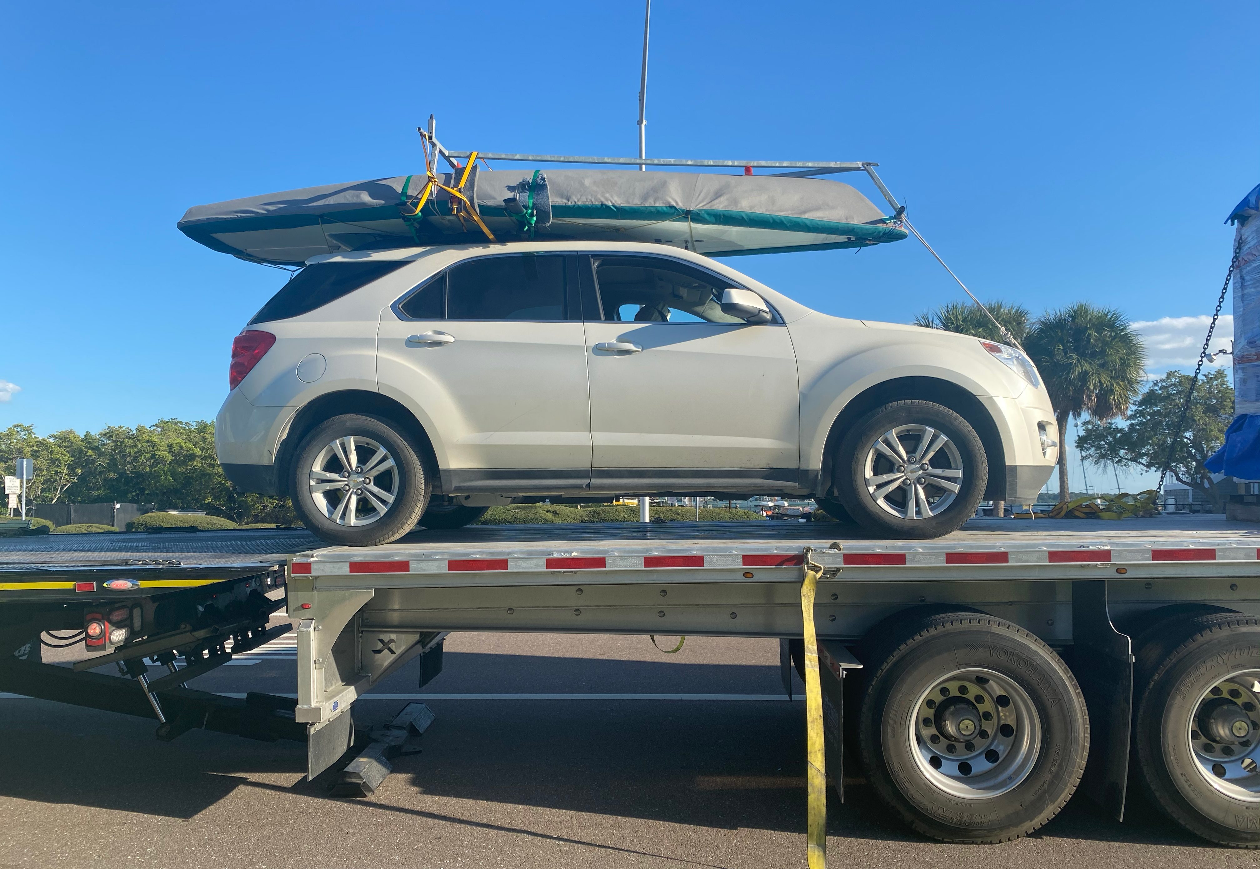 Car with boat on roof rack