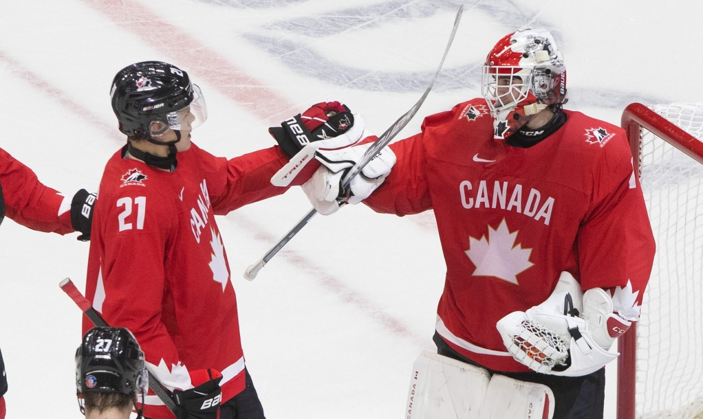 Canada's Kaiden Guhle (21) and goalie Devon Levi (1) celebrate their win over the Czech Republic during IIHF World Junior Hockey Championship action in Edmonton on Saturday, January 2, 2021. THE CANADIAN PRESS/Jason Franson