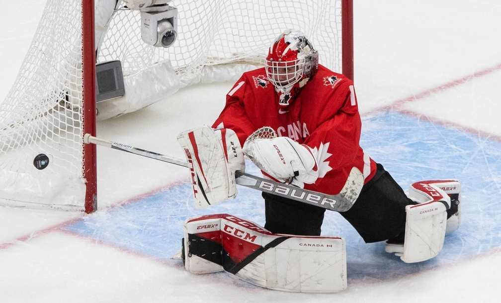Canada goalie Devon Levi (1) makes the save against the United States during first period IIHF World Junior Hockey Championship gold medal game action in Edmonton on Tuesday, January 5, 2021. THE CANADIAN PRESS/Jason Franson