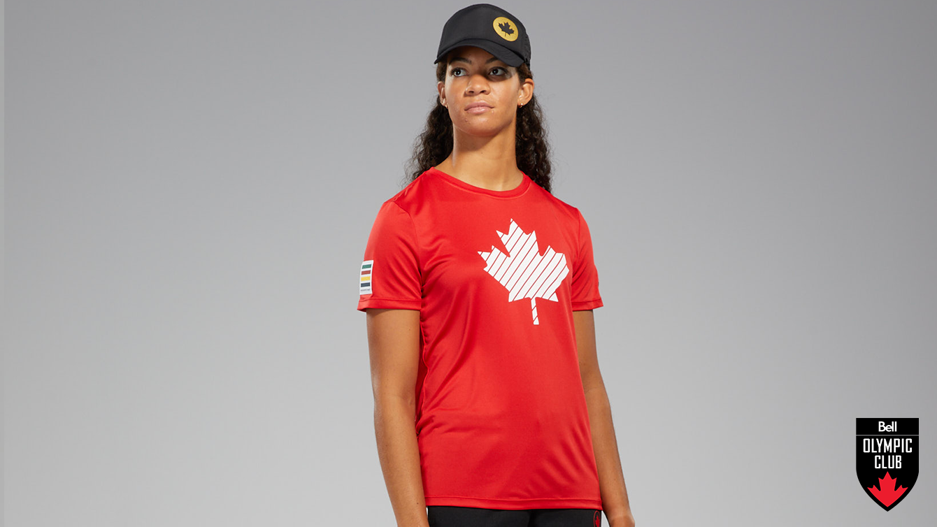 Athlete posing in red HBC shirt and black HBC hat