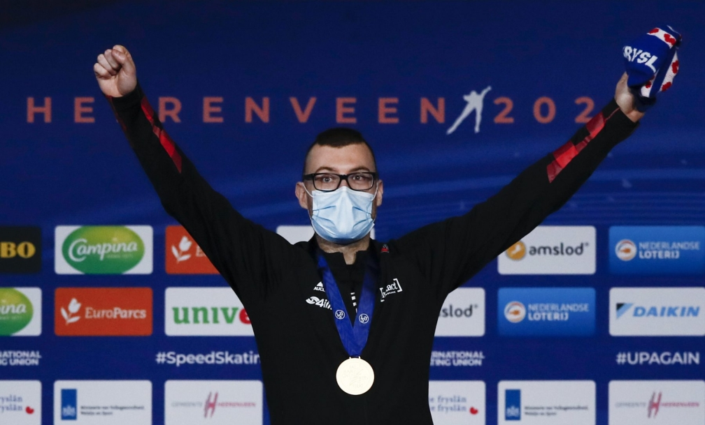 Canada's Laurent Dubreuil celebrates with his gold medal on the podium of the men's 500 meters race of the World Championships Speedskating Single Distance at the Thialf ice arena in Heerenveen, northern Netherlands, Friday, Feb. 12, 2021. (AP Photo/Peter Dejong)