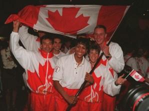 Charmaine Crooks holds the Canadian flag