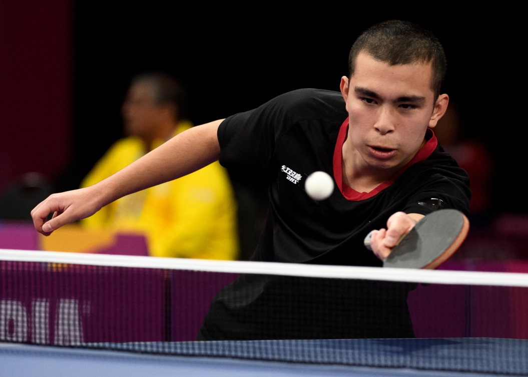 Male table tennis player prepares to return the ball
