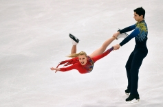 Man swings female partner in ice dance