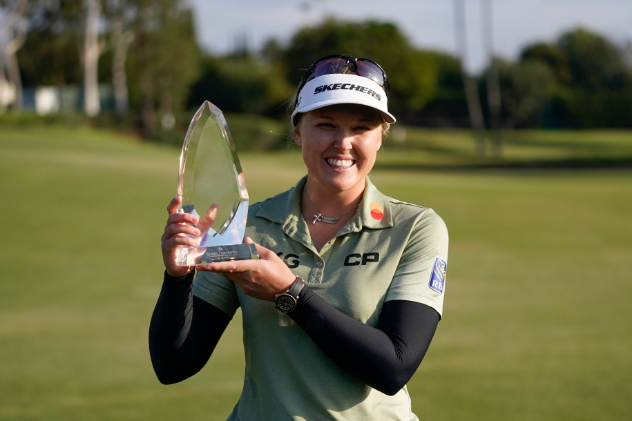 Brooke M. Henderson poses with her trophy after winning the LPGA's Hugel-Air Premia LA Open golf tournament at Wilshire Country Club Saturday, April 24, 2021, in Los Angeles.