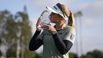 Brooke M. Henderson kisses her trophy after winning the LPGA's Hugel-Air Premia LA Open golf tournament at Wilshire Country Club Saturday, April 24, 2021, in Los Angeles.