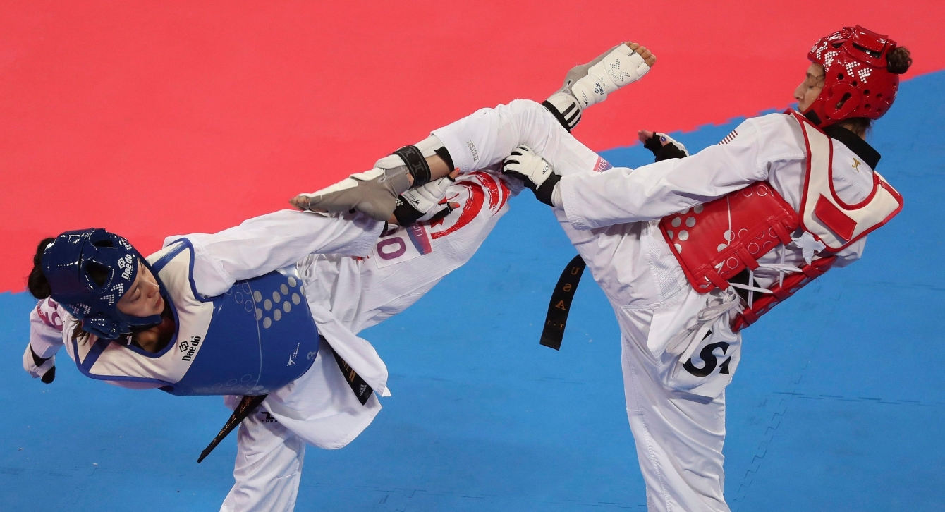 Anastasija Zolotic of the United States, right, competes with Skylar Park of Canada in the women's under 57kg Taekwondo event at the Pan American Games in Lima, Peru, Sunday, July 28, 2019. Zolotic won the gold.