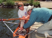 Rower Silken Laumann receives assistance adjusting her leg brace in Victoria Wednesday, June 17, 1992 from friend Peter Smith. Laumann has returned to rowing to help recover from injuries received last month at a meet in Germany.