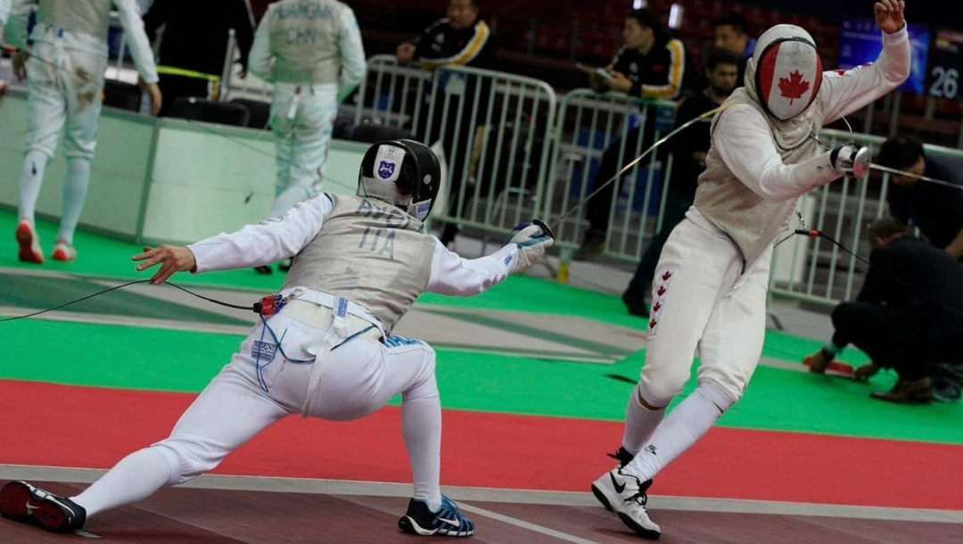 Two masked fencers mid match