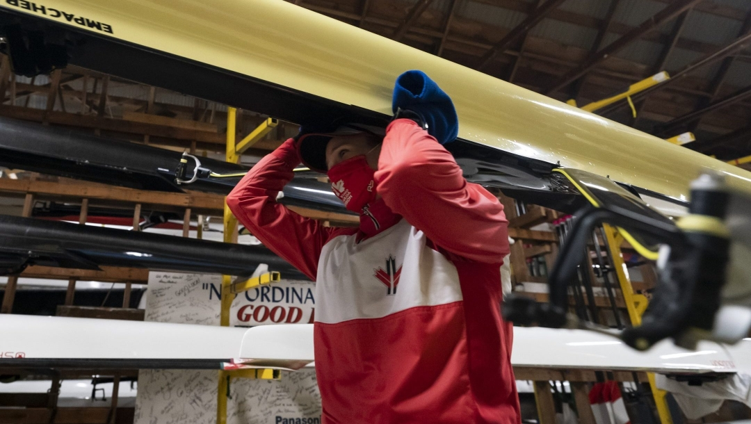 Canadian Olympic rower Carling Zeeman prepares to go out on the water at the Elk Lake training facility in Victoria, B.C., Wednesday, Dec. 9, 2020. The rowing facility which is home to national team members has employed Covid-19 protocols such as one-way walking lanes to the dock and boathouse, hand washing stations and a mask policy as athletes prepare for the rescheduled 2021 Tokyo Summer Olympics. THE CANADIAN PRESS/Jonathan Hayward