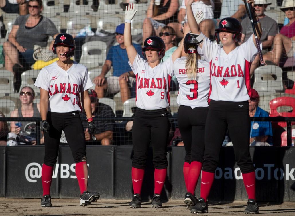 4 members of women's Team Canada's softball team cheering