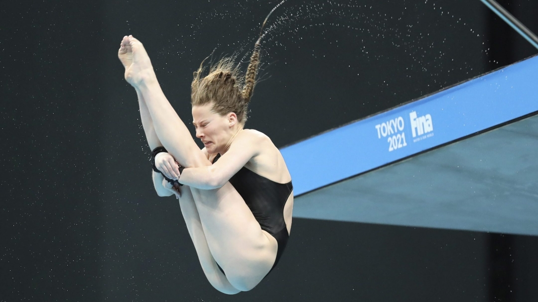Female diver in pike position in the air