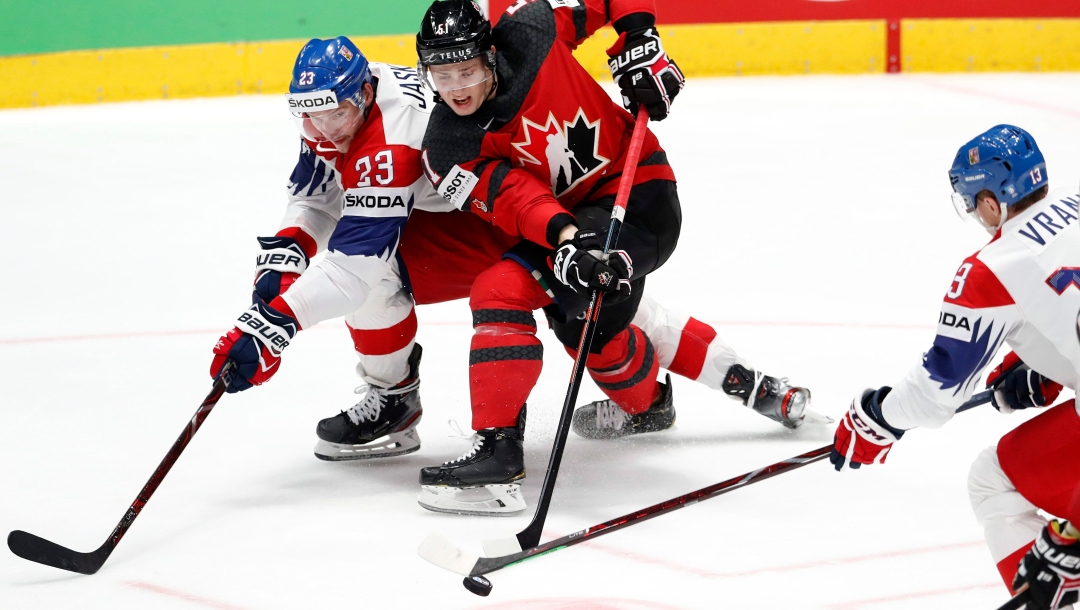 Czech Republic's Dmitrij Jaskin, left, challenges Canada's Troy Stecher for the puck during a game.