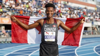 Justyn Knight poses with Canadian flag
