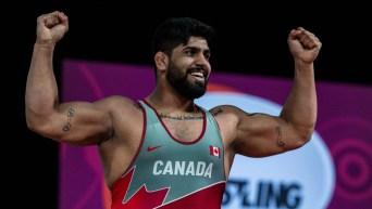 Amar Dhesi raises arms in celebration