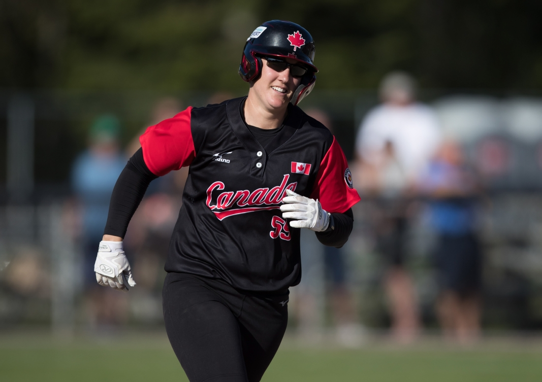Kaleigh Rafter runs the bases with a smile
