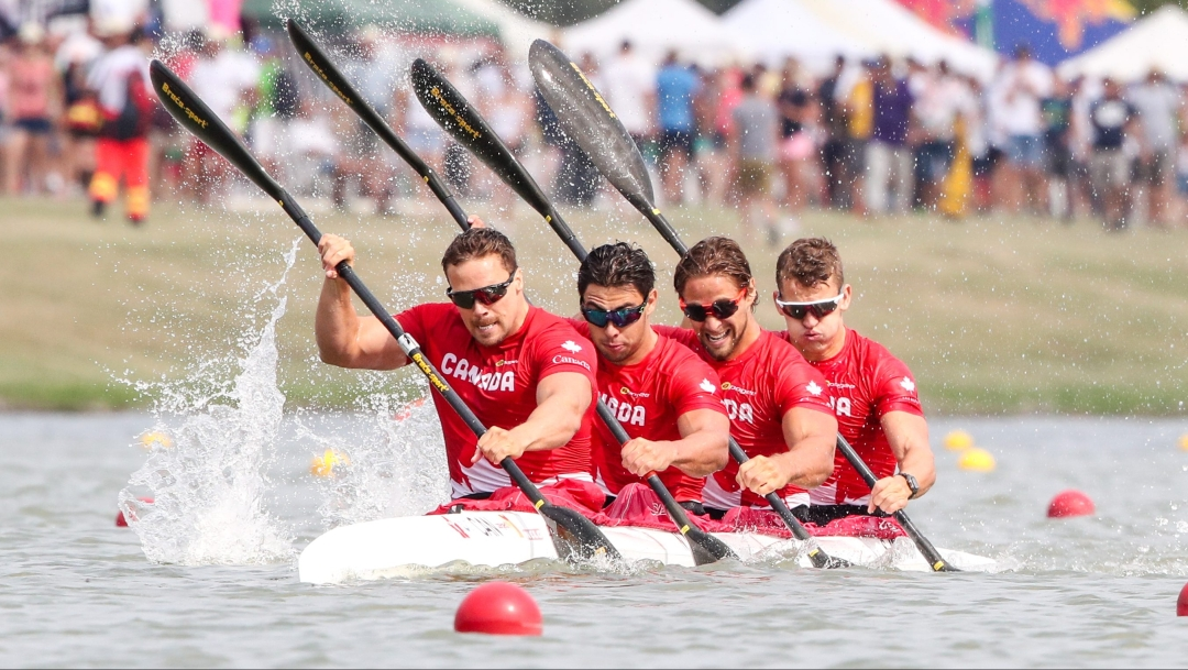 Four male kayakers in a boat