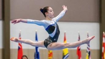 Ava Stewart does a split leap