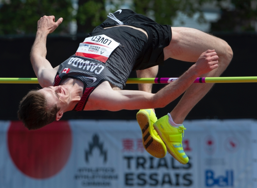 Django Lovett, from Surrey, B.C., clears 2.29m on his way to winning the Men's High Jump final on Sunday, June 27, 2021 at the Canadian Track and Field Olympic trials in Montreal. THE CANADIAN PRESS/Ryan Remiorz.